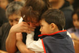 Hispanic community members from Greeley, Colorado attend an evening mass to show support for those...