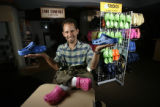 Dino Dardano, President of Dardano's Footwear in Denver, holds a pair of popular Crocs sandals....