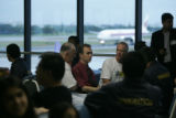 Surrounded by Thai immigrations officers and US security officials, John Mark Karr waits at the...