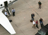 John Mark Karr is escorted off a plane by police at the Jefferson County Airport in Broomfield...