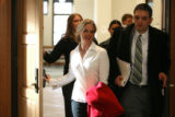 Former Brighton Charter School teacher Carrie McCandless,  leaves a Larimer County courtroom with...
