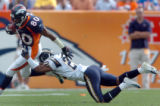 (DENVER, COLO., SEPTEMBER 26, 2004) - Denver Broncos' #80, Rod Smith trys to pull away from San...