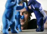 "Sculptor Lawrence Argent peers through some ""rapid prototype models in his Denver home and..."