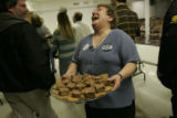 [JD458] Leslie Sheeder (cq) holds a platter of her famous oatmeal chocolate chip cookies made from...