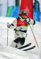 U.S. Mogul skiier Jeremy Bloom works his way through some moguls mid-course during his qualifying...
