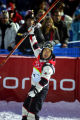 U.S. Mogul skiier Toby Dawson raises his ski over his head in celebration after his finals run...