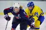 U.S. Women's Hockey Team captain Krissy Wendell (#7, F) works her way up ice with the puck as...