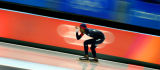 U.S. speed skater Shani Davis races around the track on his way to a silver medal during the Men's...