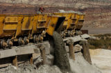 (NUCLA, Colo., March 10, 2005)  Bob Clark dumps a car of ore that came from the JD-6 mine (owned...