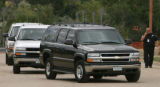 The black Chevy Suburban carrying JonBenet Ramsey murder Suspect John Mark Karr arrives at the...