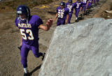 (FOUNTAIN, Co., SHOT 10/2/2004) Lake County Panthers' OL/DL Nick Palmer (#53, senior) touches...