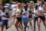 (middle three visible women starting from left girl in green) The USA's Sara Slattery, Kenya's...