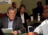 President George W. Bush delivered his weekly radio address live from the Mile High Coffee shop in...