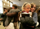 CODER101 - Hugs abound, as friends and Youth With a Mission students Hanna Blackford,  left, and...