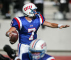 Jack Elway, son of famed football player John Elway, prepares to throw a pass during the second...