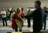 Nancy Stead complains to Denver Mayor John Hickenlooper and election officials at a polling center...