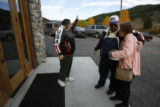 Local residents arrive for a morning service at the Platte Canyon Community Church in Bailey,...