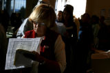 Natalie Roesch checks over her ballot sheet that helps her organize how she is going to vote while...