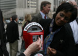 Dr. Jandel Allen-Davis plugs change into a new Donation Meter, which is part of a new plan to...
