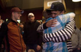DM0022   Dan Griebenow, right in stripes, gets a hug from his friend Matt Watson as members of...