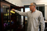 At his Niwot, Colorado office, Crocs CEO Ron Snyder reviews a pair of AVP volleyball licensed...