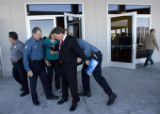 DM0204   Larry Bourbonnais is searched for weapons after being escorted out of New Life Church in...