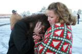 DM1129   Jenny Cartwright leans on her friend Melanie Vaughn as she waits to hear news about her...