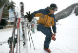Todd Metz takes off his skis after making the rounds of  ski school classes at  Winter Park,...