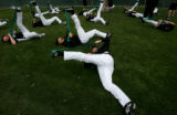 (593) Pitcher Josh Fogg, center, strecthes with other Rockies pitchers and catchers at the...