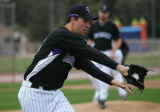 (992) Pitcher Jeff Francis practices covering first base during Colorado Rockies spring training...
