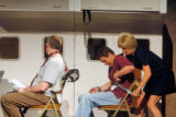 (from right) Jill Melton (cq) duck-tapes Dan Sadler (cq) to his chair as Rick Lawrence (cq)...