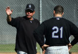 (0256) Pitching Coach Bob Apodaca talks with Jason Marquis durung Colorado Rockies spring training...
