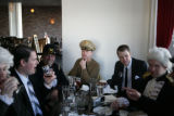 Members of the Presidents Day Society sit inside the Cheeky Monk at 534 E. Colfax Ave., in Denver,...