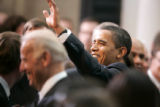 727 President Barack Obama waves to prominent Democrats after he signed the $787 billion economic...