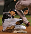 Colorado Rockies catcher Yorvit Torrealba is out sliding into second in the bottom of the third...