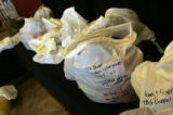 Bags of personal belongings wait to be picked up at the New Life Church Tuesday afternoon Dec. 11,...