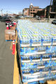 Red Cross workers distribute bottled water at a water distrubution center outside the Regional...