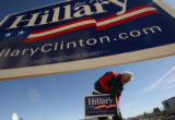 MJM108    Hillary Clinton supporter, Jack Comer (cq) of Berthoud, Colo. puts up campaign signs...