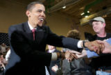 "Barack Obama shakes the hands of supporters at the ""Stand for Change""  town hall meeting..."