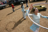 MJM179   Hoola hoop artist, Anne Dellinger (cq), 31, of Golden, Colo. warms up for the annual...