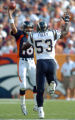 (DENVER, COLO., SEPTEMBER 26, 2004) - Denver Broncos #16, Jake Plummer, left, gets rid of the ball...