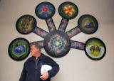 Facilities Director at the Auraria Campus Jim Fraser, stands in front of a scientific mural at the...