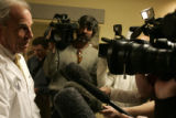 University of Colorado President Bruce Benson talks to the press after watching senior nursing...