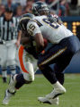 (DENVER, COLO., SEPTEMBER 26, 2004) - Denver Broncos #52, D.J. Williams wraps up San Diego...