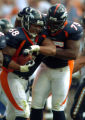 (DENVER, COLO., SEPTEMBER 26, 2004) - Denver Broncos Mario Fatafehi. #68, celebrate recovering a...