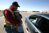 Vounteer Larry Jack, working at the City's main water tower,hugs his son  Hunter , middle, after ...
