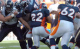 (DENVER, COLO., SEPTEMBER 26, 2004) - Denver Broncos #22, Quentin Griffin, center, has no where to...