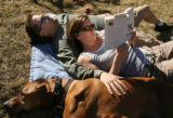 MJM331  Andra Beemer (cq), of Denver, Colo. reads the book, Eat, Pray, Love as she rests near her...