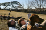 MJM360  Andra Beemer (cq), of Denver, Colo. reads the book, Eat, Pray, Love as she rests near her...