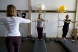 Instructor Stephanie Parker 32, (CQ)of Wheatridge, on left,  holds a pilates classf students in...